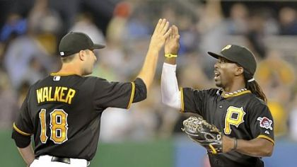 Pirates second baseman Neil Walker celebrates with center fielder Andrew McCutchen after beating the Marlins, 4-3, Friday at PNC Park.