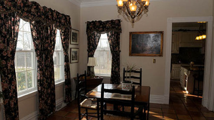 The dinning room features hard wood floors and plenty of natural light.