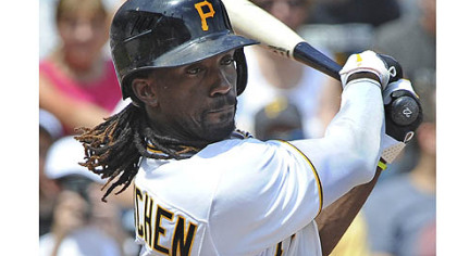 Pirates' Andrew McCutchen singles in the first inning against the Marlins.