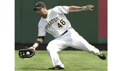 Pirates' Garrett Jones makes a diving catch in right field against the Marlins.