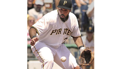 Pirates' Pedro Alvarez can not handle the hard hit ball by the Marlins' Logan Morrison.