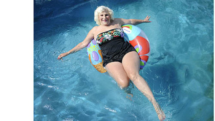 Dolores Grandizio, 83, floats in her pool in Valencia.  Ms. Grandizio, who has had surgery on her spine to correct scoliosis, said swimming and dancing are her two favorite ways to exercise.