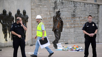 Police and construction workers have surrounded the Joe Paterno statue in State College on Sunday.