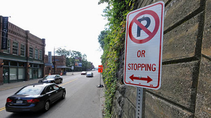 "A haven of free street parking on eastbound East Carson Street has ended with the posting of ""no parking"" signs. The area will become a bike lane."