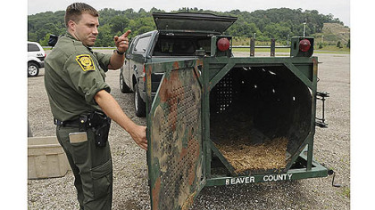 State wildlife conservation Officer Matt Kramer shows a bear trap that had been set Monday near the Pittsburgh Mills mall in Frazer.