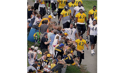 Fans reach out to touch Ben Roethlisberger and Troy Polamalu before camp begins.