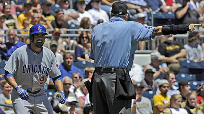 Cubs&#039; David DeJesus is told to go back to second base by home plate umpire Andy Fletcher after a hit to deep center was reviewed and ruled a ground-rule double against the Pirates Wednesday afternoon.
