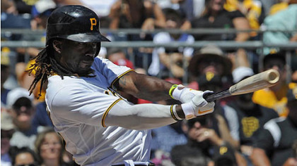 Pirates centerfielder Andrew McCutchen gets a hit in the sixth inning against the Cubs this afternoon at PNC Park.
