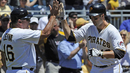 Pirates Neil Walker is congratulated by third base coach Nick Leyva after hitting a home run in the first inning against the Cubs Wednesday afternoon.