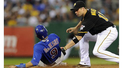 Cubs' David DeJesus gets into second base safely as Pirates' Neil Walker applies the tag in the seventh inning at PNC Park Tuesday night.