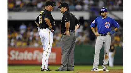 Pirates manager Clint Hurdle argues with second base umpire Rob Drake after Cubs' David DeJesus was called safe at second base on a tag by Pirates' Neil Walker in the seventh inning.