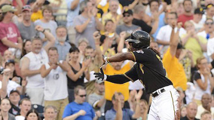 Andrew McCutchen makes the sign of Zoltan after hitting triple.