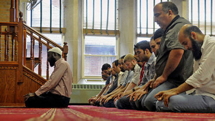 An afternoon prayer is led by Imam Abdusemih Tadese, left, at the Islamic Center of Pittsburgh in Oakland on July 18 ahead of Ramadan, which began Friday.