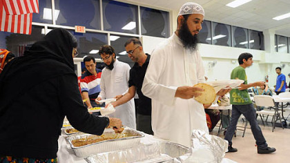 Muslim men and women break their Ramadan fasts for the evening at the Muslim Community Center in Monroeville.