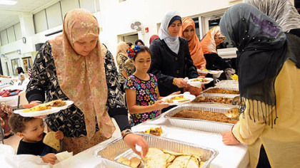 Pittsburgh Muslims enjoy iftar, the evening feast when Muslims break fast during the Islamic holy month of Ramadan, at the Muslim Community Center in Monroeville on Monday.