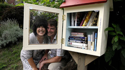 Lisa Ciccarelli and her husband Rick McGee with their Word House on Biddle Avenue in Regent Square. The little free lending library is part of a nationwide movement, and the rules are simple: take a book, leave a book.