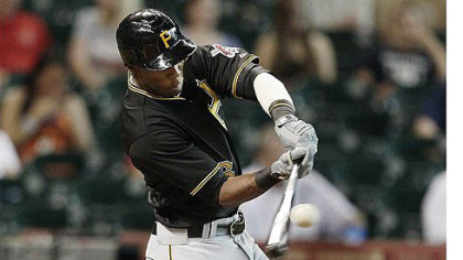 Starling Marte drives a ball to left center field for a home run in the first inning against the Houston Astros.