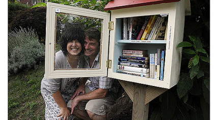 Lisa Ciccarelli and her husband, Rick McGee, with their Word House on Biddle Avenue in Regent Square. The Word House is a small free lending library where anyone can take a book after leaving one. The idea is part of a national trend, as found at www.freelibrary.org.