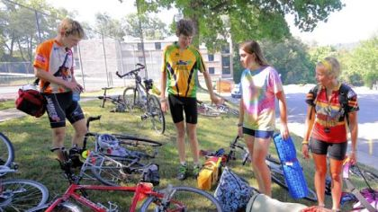 Cyclists from the Jett Foundation stopped at Geneva College as they ride across the country raising money and awareness for Duchenne muscular dystrophy. From left are Drew Gottman, 17, and Mac Sullivan, 17, both from Montana; Courtney Burt, 16, from Massachusetts; and Megan Drake, 15, from New York.