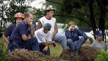 July 27, 2002: Emergency workers and other residents of the Quecreek area waited as drilling rigs raced to get trapped miners out of the flooded Quecreek Mine.