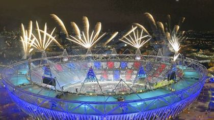 Fireworks illuminate the sky over Olympic Stadium during Opening Ceremonies at the 2012 Summer Olympics, Saturday, July 28, 2012, in London.