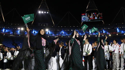 Saudi Arabia's athletes parade during the Opening Ceremony at the 2012 Summer Olympics, Friday, July 27, 2012, in London.