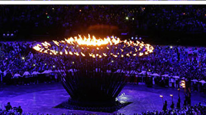 This series of photos shows the Olympic flame as it is lit during the Opening Ceremony at the 2012 Summer Olympics, Saturday, July 28, 2012, in London.