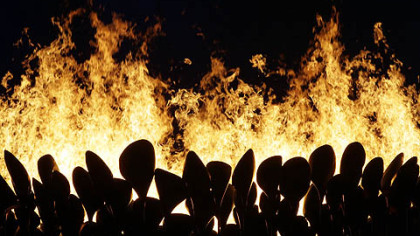 The Olympic cauldron is lit during the Opening Ceremony at the 2012 Summer Olympics, Saturday, July 28, 2012, in London.