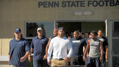 Penn State football team give a statement in support of their team outside of the Lasch building on the Penn State University campus.