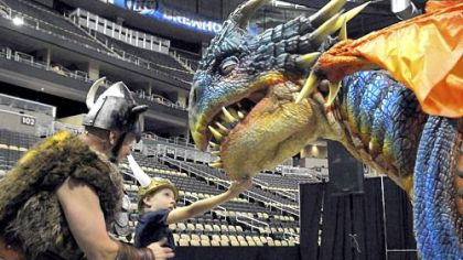 "Sig the Viking shows Caden Suba, 8, of Franklin Park to find the ""soft spot"" of baby dragon Nadder at the How to train your dragon Live Spectacular preview July 26 at Consol Energy Center."
