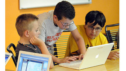 From left, Ethan Thoma, Carson Tokar and Broc Balta work on creating an online game.