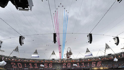 The Red Arrows squad makes a flyover ahead of the Opening Ceremony above the 2012 Olympic Summer Games at the Olympic Stadium, London, today.