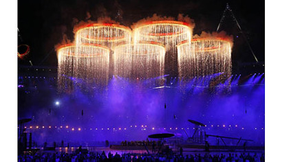The Olympic rings are illuminated with pyrotechnics as they are raised above the stadium during the Opening Ceremony at the 2012 Summer Olympics in London.