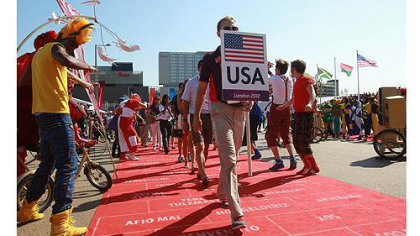 The United States team enjoys the atmosphere during the Olympic Village arrivals ahead of the London 2012 Olympics at the Olympic Park )