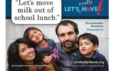 "Billboard showing Stanton Heights resident Leah Lizarondo-Shannon, her husband Bill Shannon and their two children saying ""Let's move milk out of school lunch."""