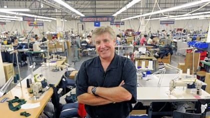 Philadelphia-made uniforms for the 2012 Olympics are designed and manufactured at Boathouse Sports. The company employs about 225 local workers. Here, founder John Strotbeck stands on the sewing floor.