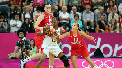 Swin Cash (#11) of United States fights for possession of the ball against Luca Ivankovic (#14) and Iva Ciglar (#10) of Croatia.