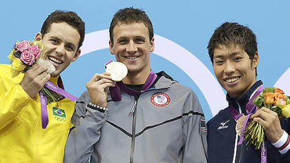 Brazil&#039;s Thiago Pereira, United States&#039; Ryan Lochte and Japan&#039;s Kosuke Hagino pose with their medals for the men&#039;s 400-meter individual medley swimming final. Lochte won gold, Pereira silver and Kosuke bronze.