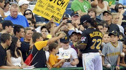 Andrew McCutchen stops to sign autographs before the start of a game Tuesday against the Cubs at PNC Park.