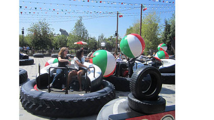 At Luigi's Flying Tires at Disney California Adventure, riders sit atop giant tires and angle to grab giant beach balls to toss at other tire jockeys.
