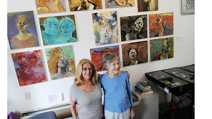 "Artist Donna Hollen Bolmgren, right, in front of work from her show ""Journey ... Most Recent Works,"" with longtime friend and owner of Gallerie Chiz in Shadyside, Ellen Chisdes Neuberg."