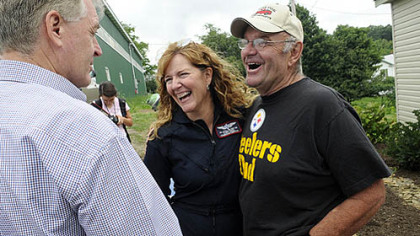 Quecreek mine survivor John Unger, right, shares a laugh Saturday with Jill Stull, a flight nurse for Conemaugh Memorial Medical Center, and former Gov. Mark Schweiker at the 10th anniversary celebration of the rescue at the site of Quecreek Mine in Somerset.
