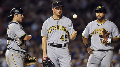The Pirates' Michael McKenry, left, and Pedro Alvarez, right, watch as pitcher Erik Bedard tosses the ball in the air after giving up a three-run home run to the Cubs' Anthony Rizzo during the fifth inning Monday in Chicago.