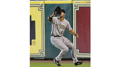 Pirates' Garrett Jones catches a ball for an out against the Houston Astros in the fourth inning.