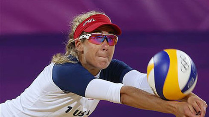 April Ross of US dives for a ball during the Beach Volleyball match against Argentina at the 2012 Summer Olympics, Sunday, July 29, 2012, in London.
