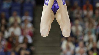 U.S. gymnast Kyla Ross performs on the balance beam during the Artistic Gymnastics women's qualification at the 2012 Summer Olympics, Sunday, July 29, 2012, in London.
