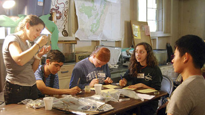 Students at the National Youth Science Camp, held at Camp Pocahontas in West Virginia, study the effects of carnivorous juices from pitcher plants.