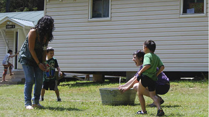 The National Youth Science Camp has been held at Camp Pocahontas, a 4H site, since 1963. Even playtime involves science as Shana Rose sprays friends with a