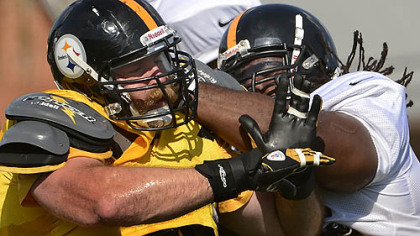 Defensive end Brett Keisel battles Willie Colon during afternoon workouts at training camp.