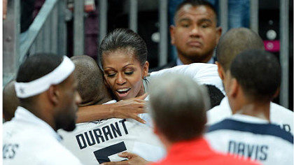 First lady Michelle Obama congratulates Kevin Durant and the U.S. men's basketball team after its win.